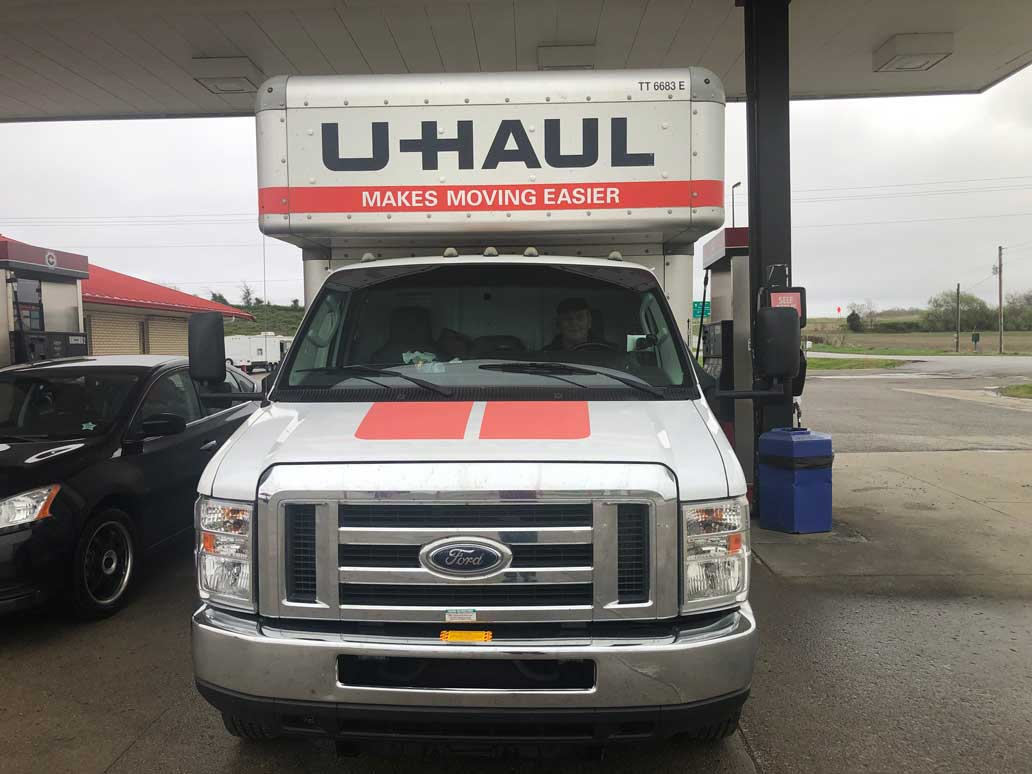 Bill in a U-Haul truck at a gas station
