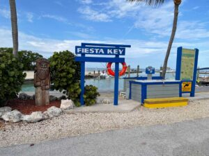Fiesta Key sign in front of marina