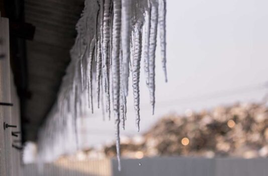 Icicles on the edge of the roof of a house